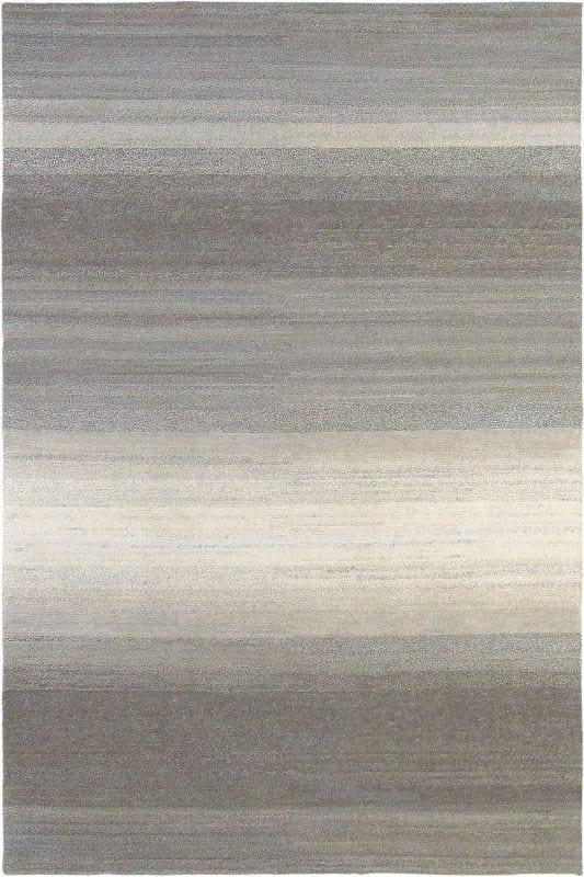 Vloerkleed Yeti Cloud 51214 van Brink & Campman is een exclusief handgeknoopt karpet met een eigenzinnig strepen, verloop design. Het vloerkleed is samengesteld uit scheerwol en is uitgevoerd in de kleur grijs. Het kleed heeft een afmeting van 140 x 200 cm.
