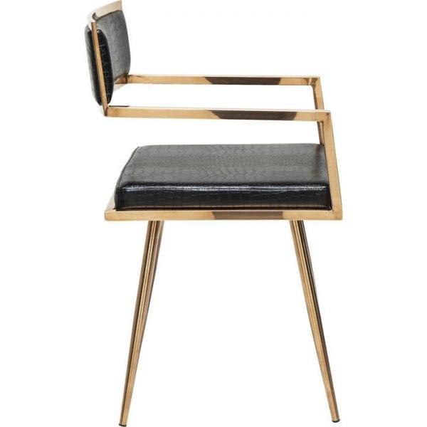 Kare Design Armstoel Jazz Rosegold 79570 Stoel: sculpturale zitplaatsen. De Jazz-serie is een luxelijn die aan alle eisen voor comfort en stijl voldoet. Deze mooie meubelserie staat garant voor een vleugje decadentie en glamour in je eigen vier muren. Jazz verandert elke kamer in een salon. Het exclusieve design, het rechte silhouet en de nonchalante flamboyantie maken onze Jazz-fauteuil tot een echt meesterwerk. De designelementen zijn gebaseerd op antieke Griekse modellen en zorgen zo voor een tijdloos en nobel karakter naast de glamoureuze uitstraling. Deze indruk wordt onderstreept door de rechte en strakke vormen en door de klassieke kleurencombinatie van zwart en goud, die er altijd exclusief en elegant uitziet. De luxueuze hoes in de zwarte krokodillenleren look en het opvallend gevormde frame van goudkleurig roestvrij staal gaan een spannende samenwerking aan en geven deze stoel een glamoureus en elegant karakter. Wie op onze stoel zit, weet hoe hij de toon moet zetten en een opvallende presentatie kan maken. Zo'n geweldig ontwerp komt zelden alleen. Jazz is beschikbaar als een serie. - Lowik Meubelen
