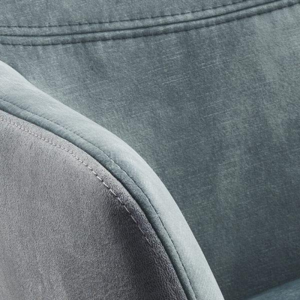 Armstoel Vigio uitgevoerd in stof adore 158-niagara (voorzijde) en microleder bora 158- niagara (achterzijde) met zwarte metalen poot met terugdraai-mecha- nisme