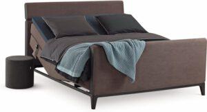 Boxspring Criade van Auping, afgebeeld met hoofdbord Bend, stel uw bed naar wens samen!