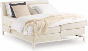 Boxspring Criade van Auping, afgebeeld met hoofdbord Curl, stel uw bed naar wens samen!